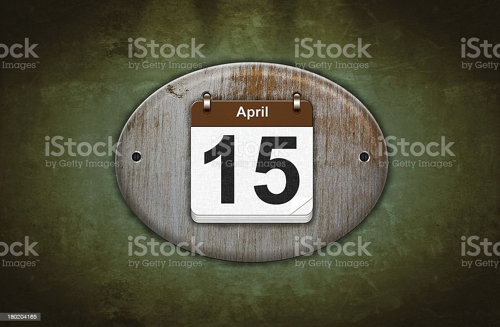 Old wooden calendar with April 15. stock photo