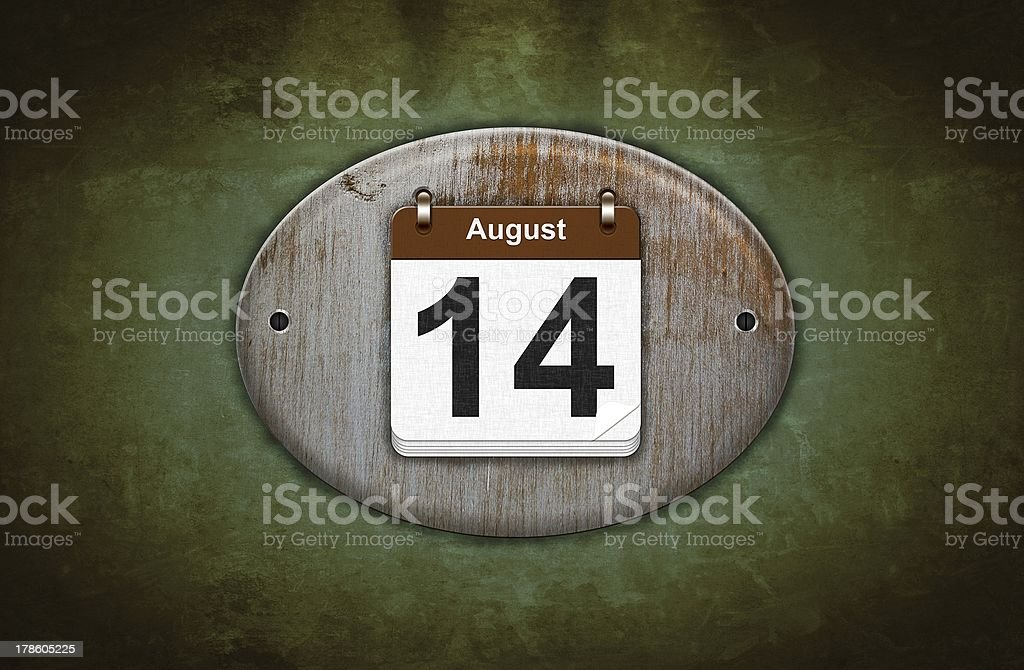 Old wooden calendar with August 14. stock photo