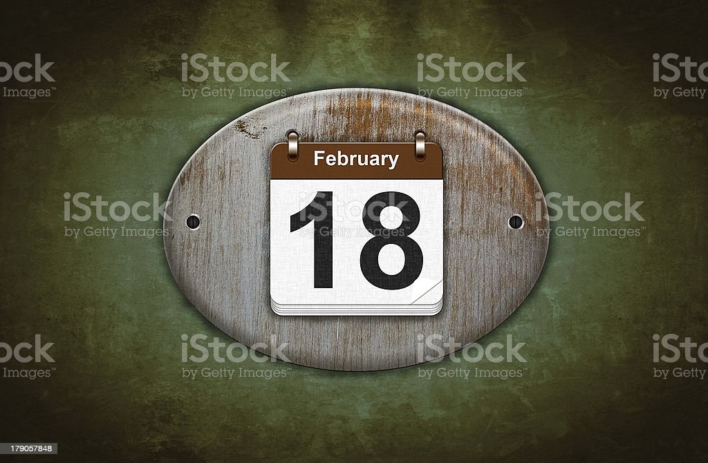 Old wooden calendar with February 18. royalty-free stock photo