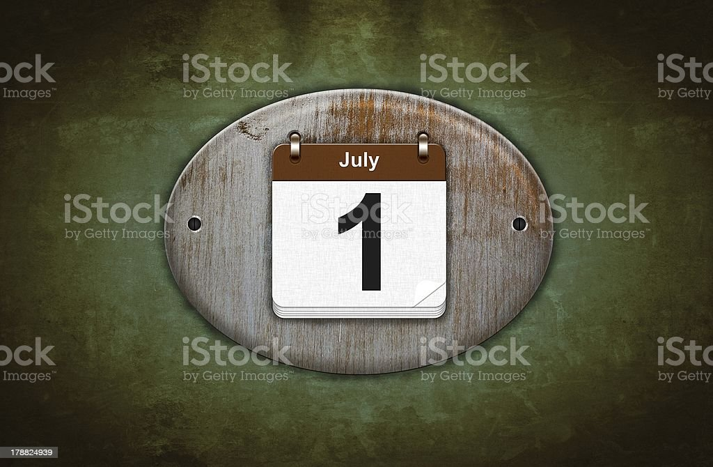 Old wooden calendar with July 1. stock photo