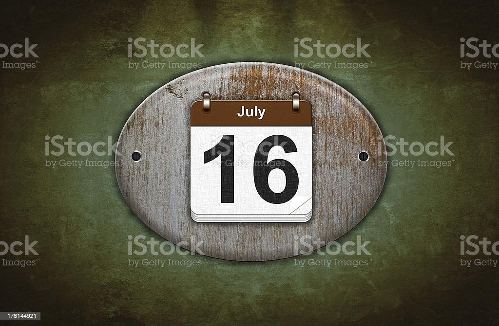 Old wooden calendar with July 16. stock photo