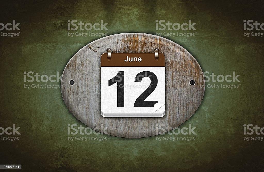 Calendário de madeira velha com 12 de junho. - foto de acervo