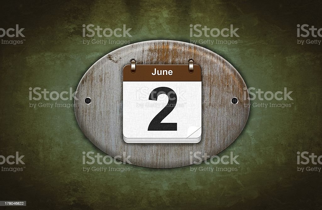 Old wooden calendar with June 2. stock photo