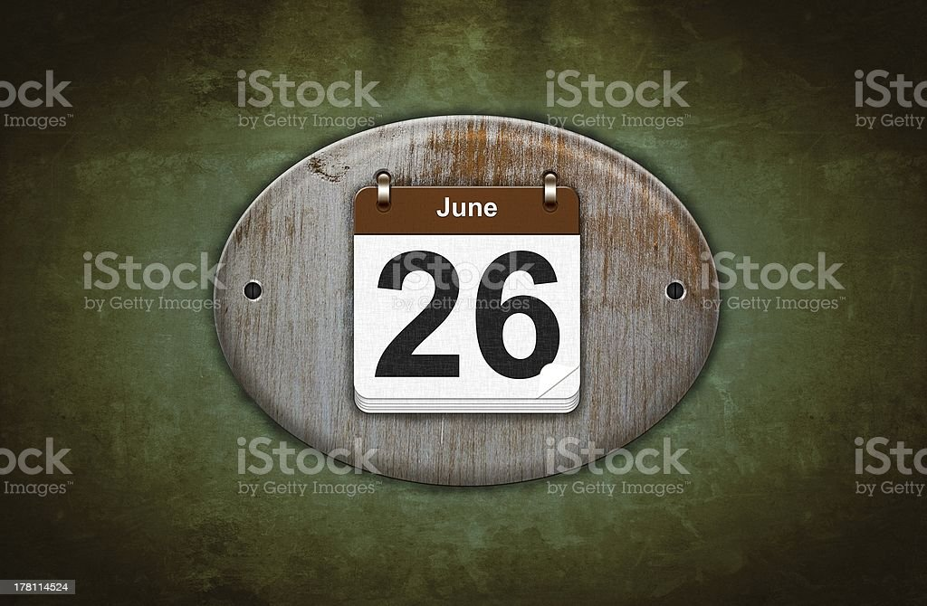 Old wooden calendar with June 26. stock photo
