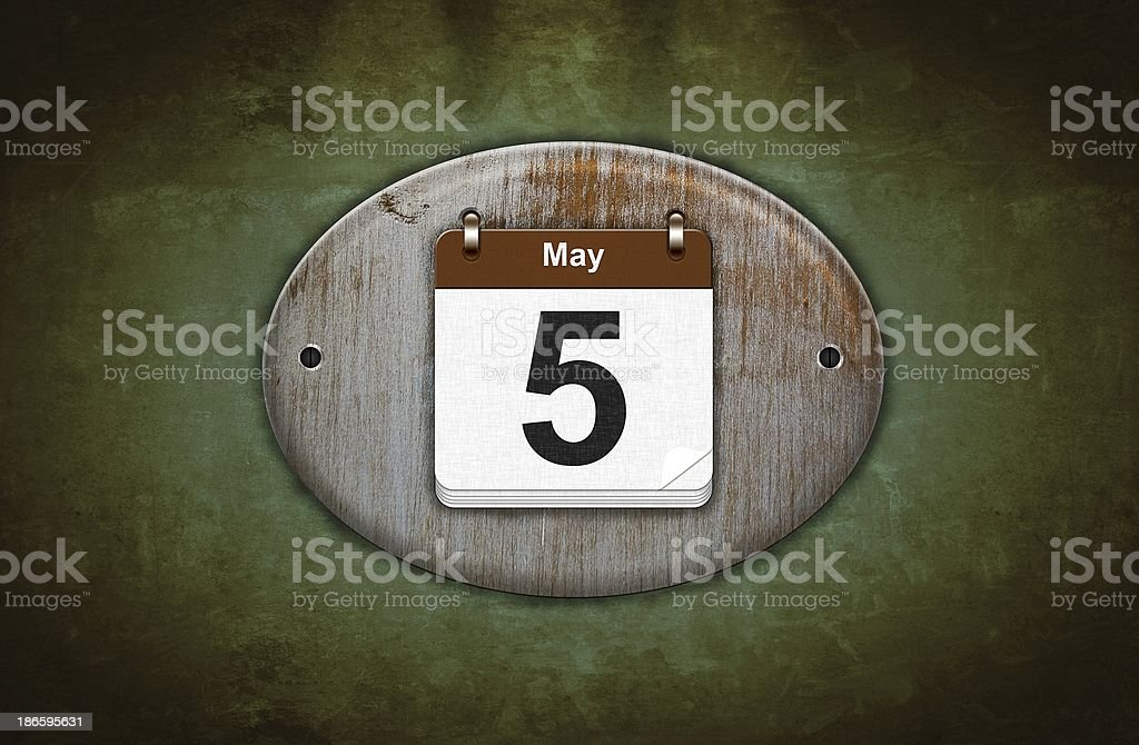 Old wooden calendar with May 5. stock photo