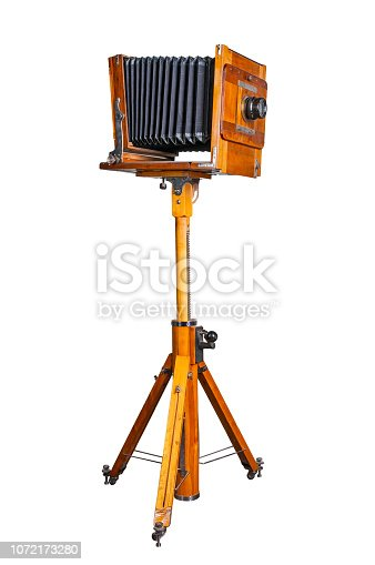 Old wooden camera on white background