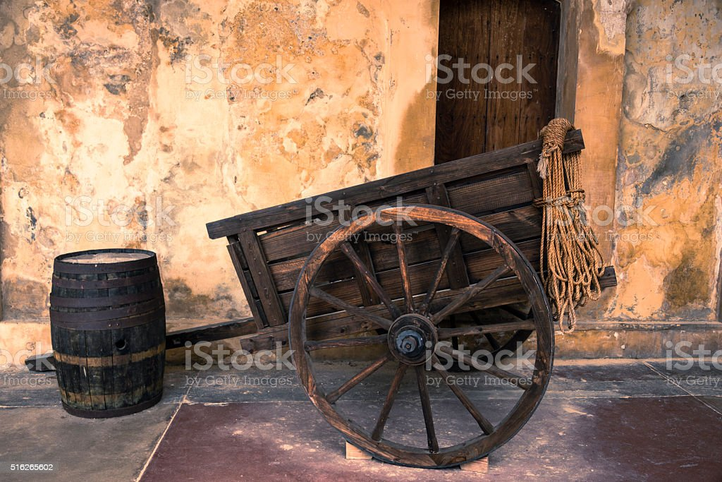 Old wooden cart and barrel. stock photo