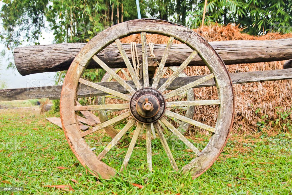 old wooden cart wheel stock photo