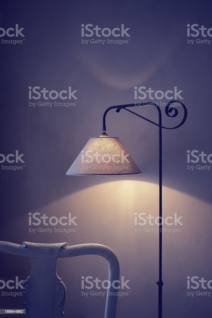 Old Wooden Chair with Metal Lamp Interior stock photo