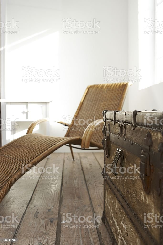 old wooden chest and brown canvas chair royalty-free stock photo