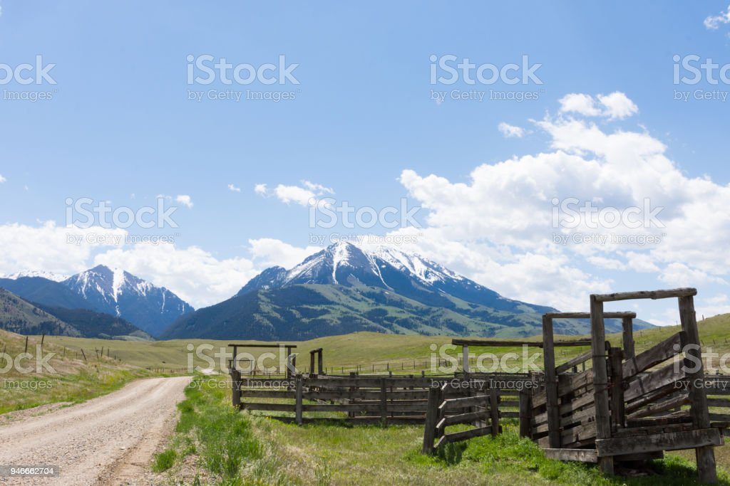 Old Wooden Corral with Rugged Mountains stock photo