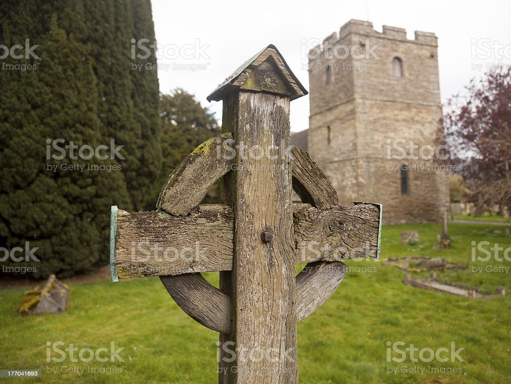 Old wooden cross in Stokesay graveyard stock photo