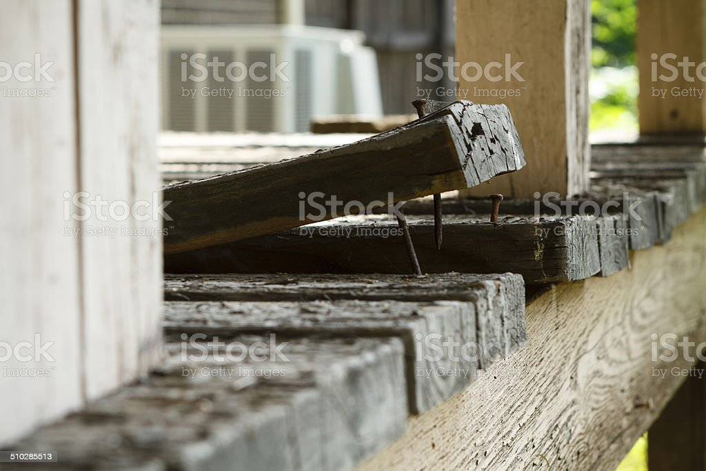 Old Wooden Deck Board Plank Curling Up stock photo
