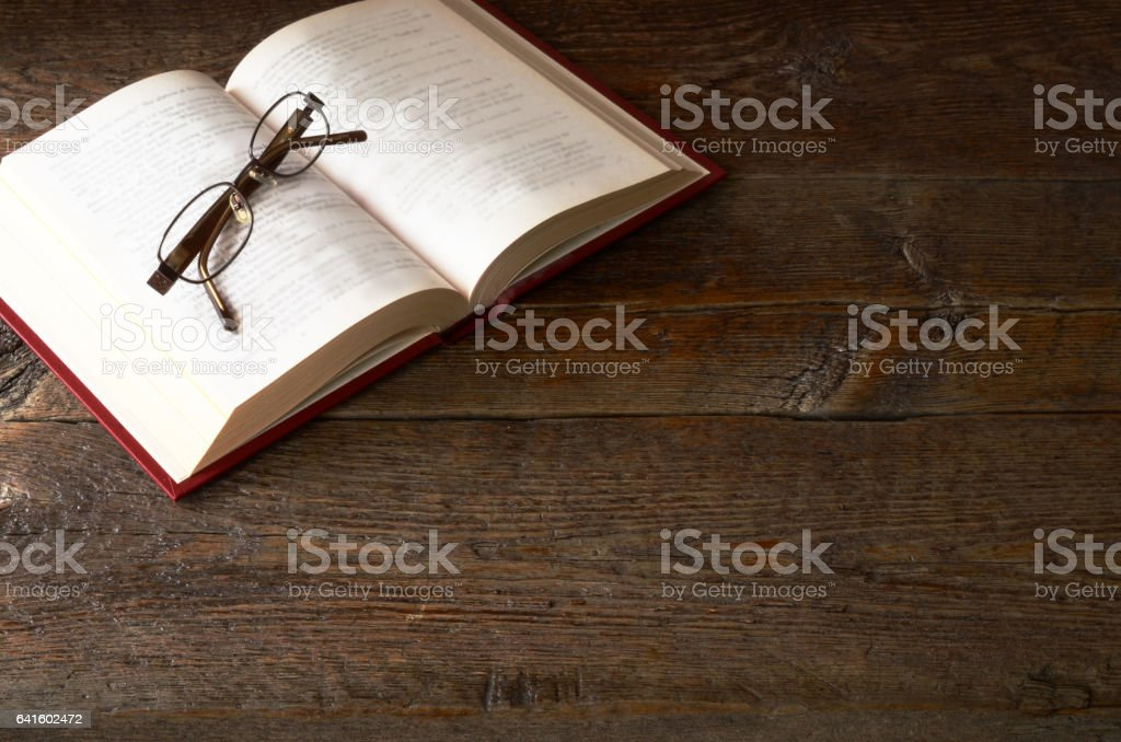 Old Wooden Desktop and Open Book stock photo