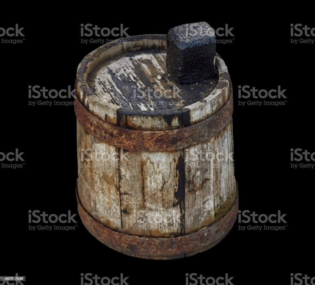 Old wooden dirty barrel for fuel oil on isolated black background - Royalty-free Antique Stock Photo