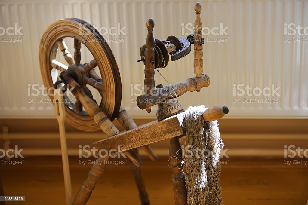 Old wooden distaff stock photo