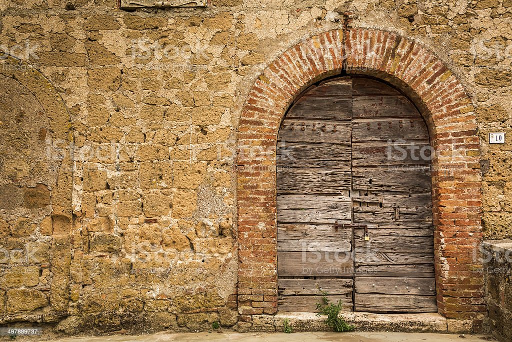 Old wooden door and brick wall stock photo