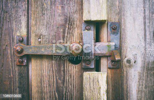 An old metal latch on a wooden door.