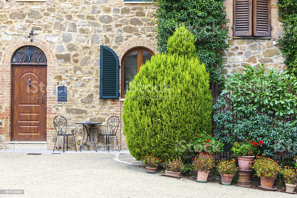 Old Wooden Door And Plants, Tuscany, Italy stock photo