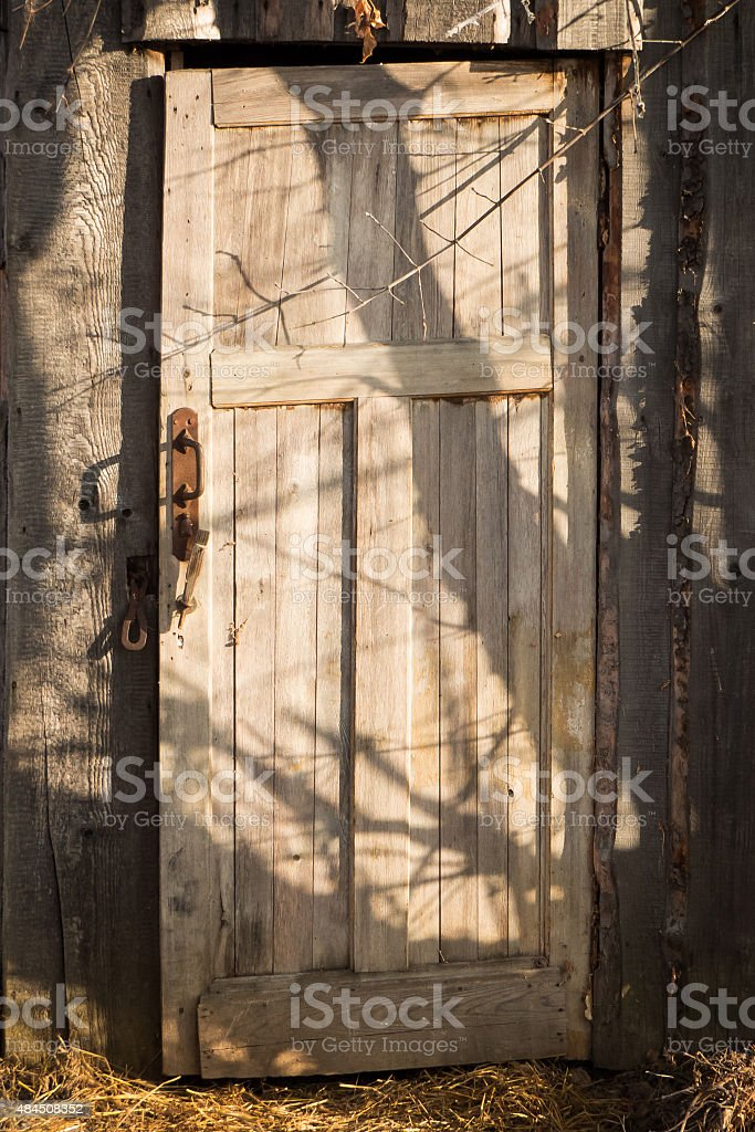Old wooden door and shadows. stock photo