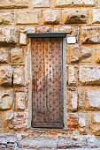 Old wooden door and stone wall