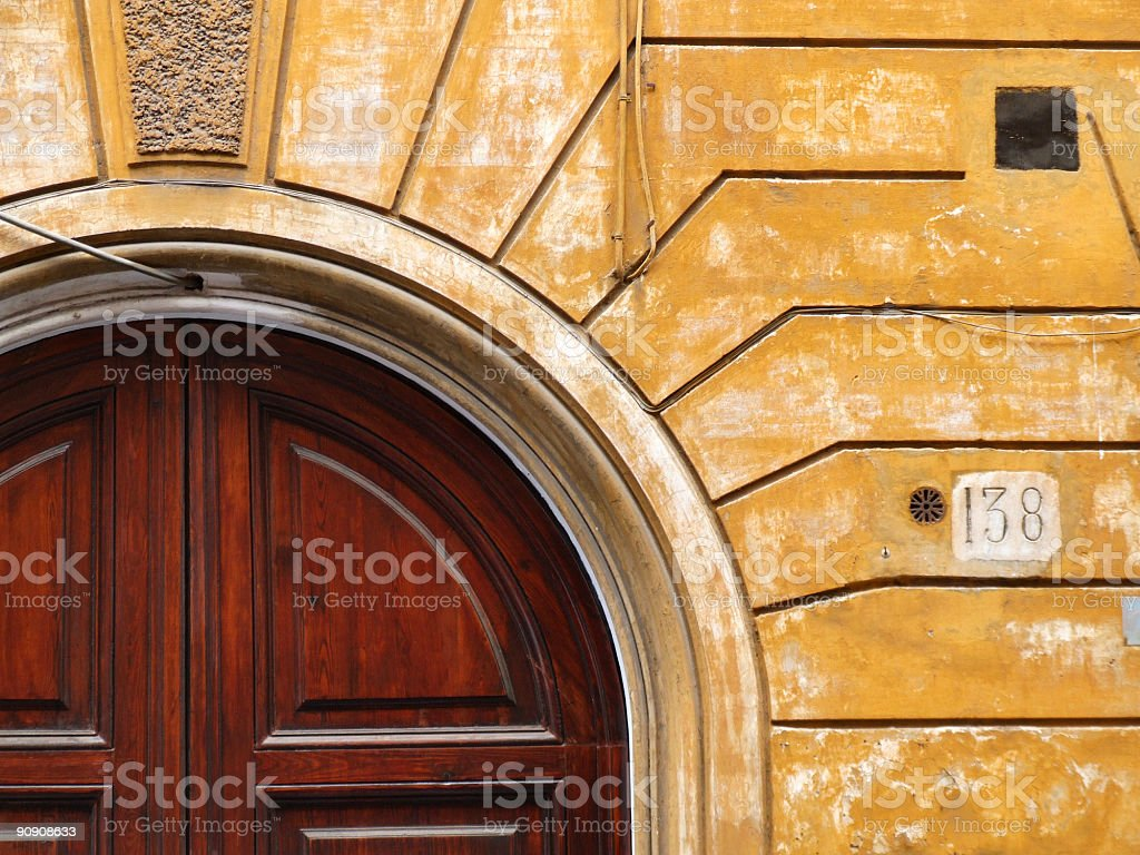 Old wooden door and yellow wall royalty-free stock photo