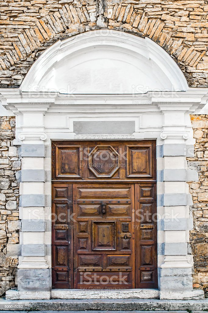 Old wooden door architecture details entrance from 17th century stock photo