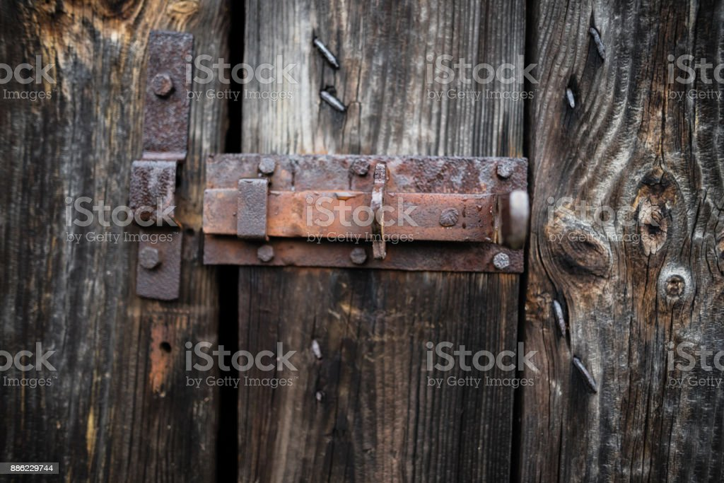 Old wooden door – door latch stock photo