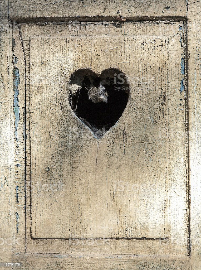old wooden door in meran, Tirol, Italy with a heart royalty-free stock photo