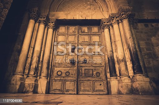 Old wooden door of entrance to the Church of the Holy Sepulchre, also called the Church of the Resurrection or Church of the Anastasis, in Old City of Jerusalem.