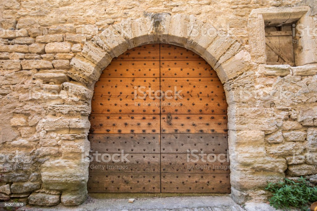 Old wooden door on stone house  in Gordes. Provence, France stock photo