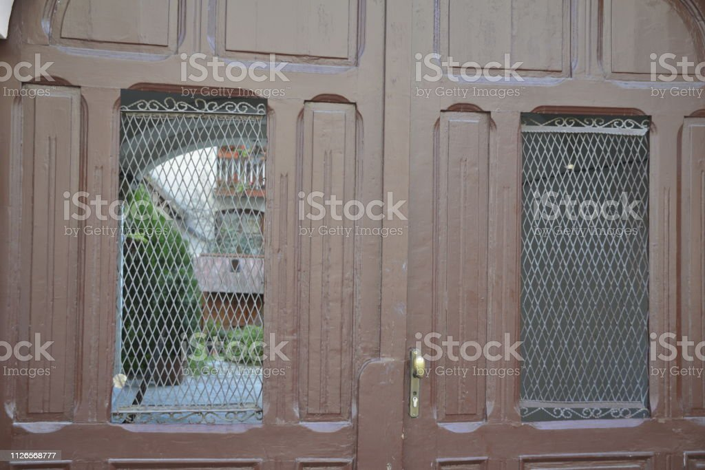 Old wooden door on the gate, at the entrance to the front yard