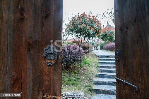 old wooden door to garden