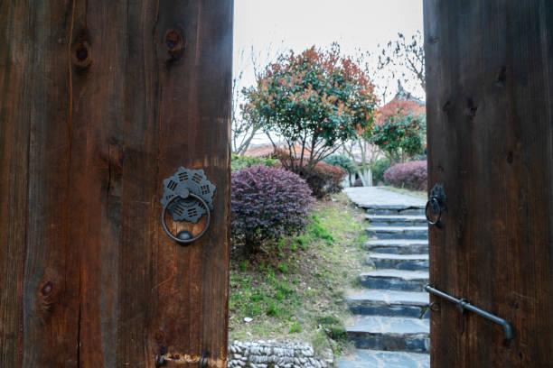 old wooden door to garden stock photo