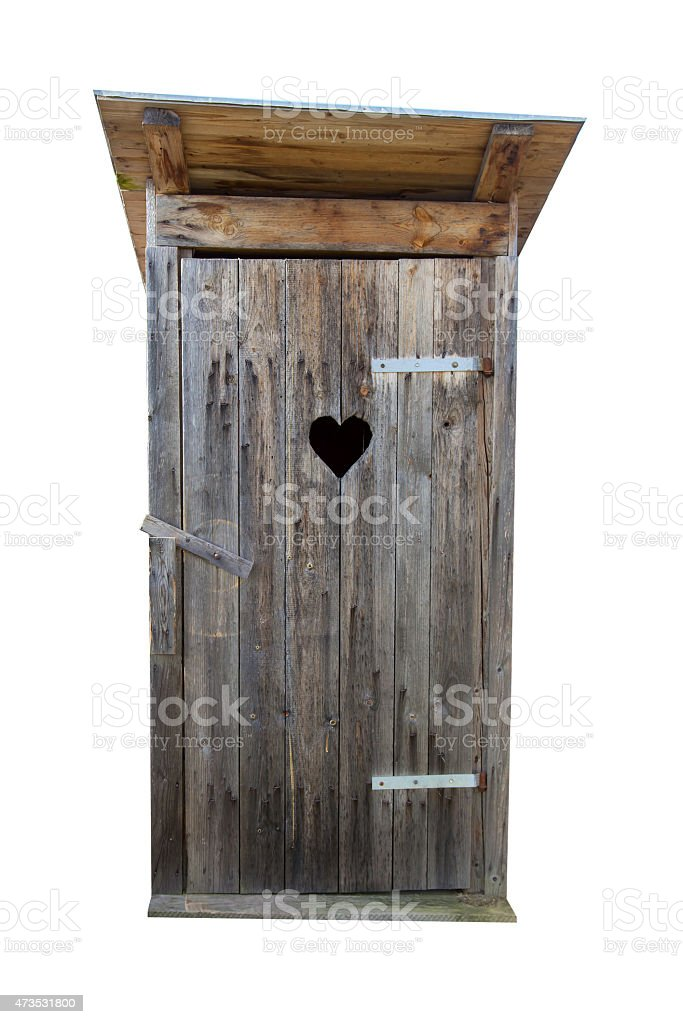 Old wooden door to outhouse with heart shaped opening stock photo