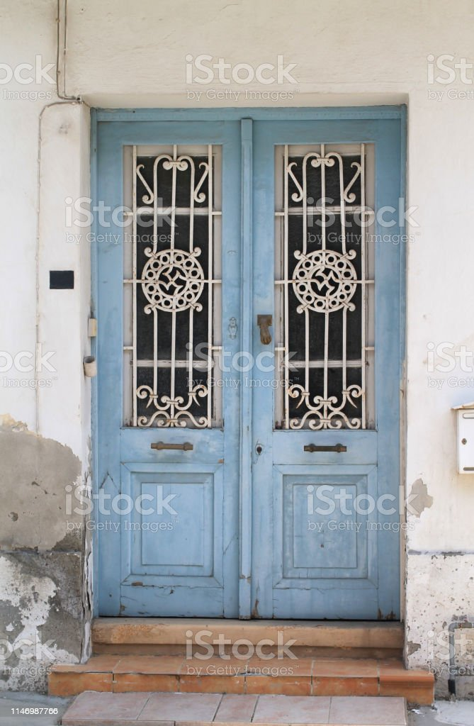 Old Wooden Door With Glass Panels And Metal Grates Stock Photo Download Image Now Istock
