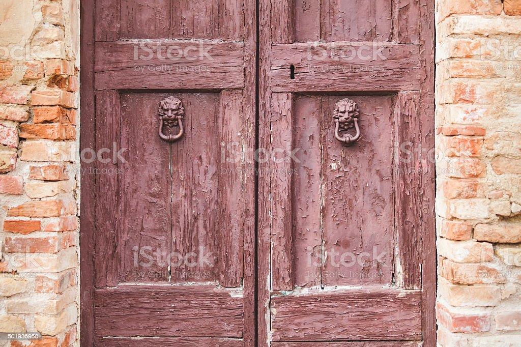 Old Wooden Door with Lion Head Knockers stock photo