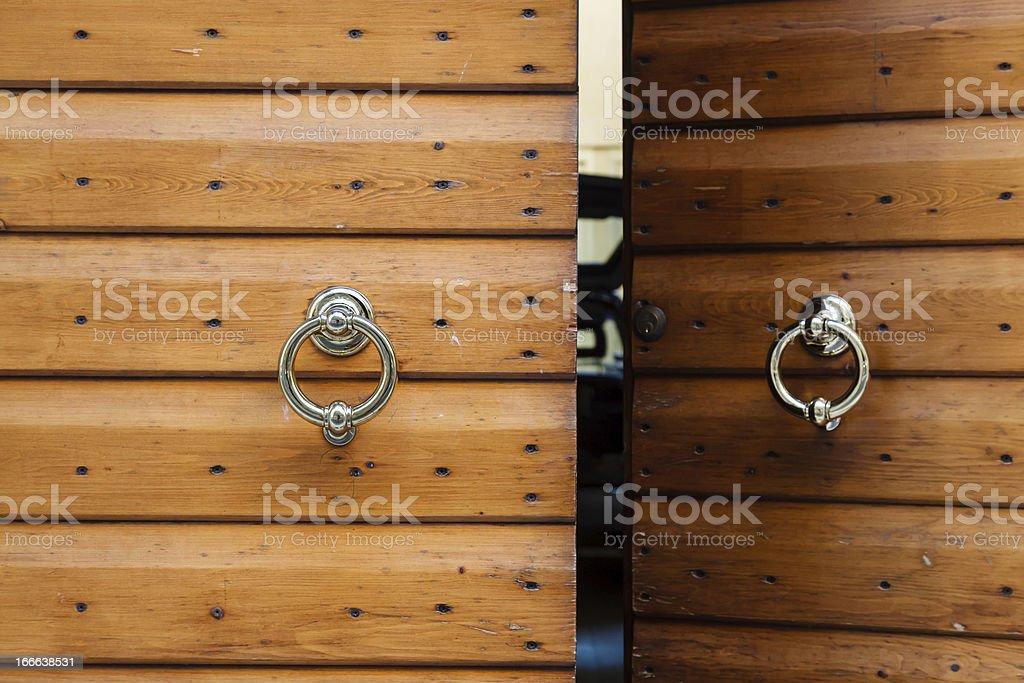 Old Wooden Door with Metal Knockers in Verona, Veneto, Italy royalty-free stock photo