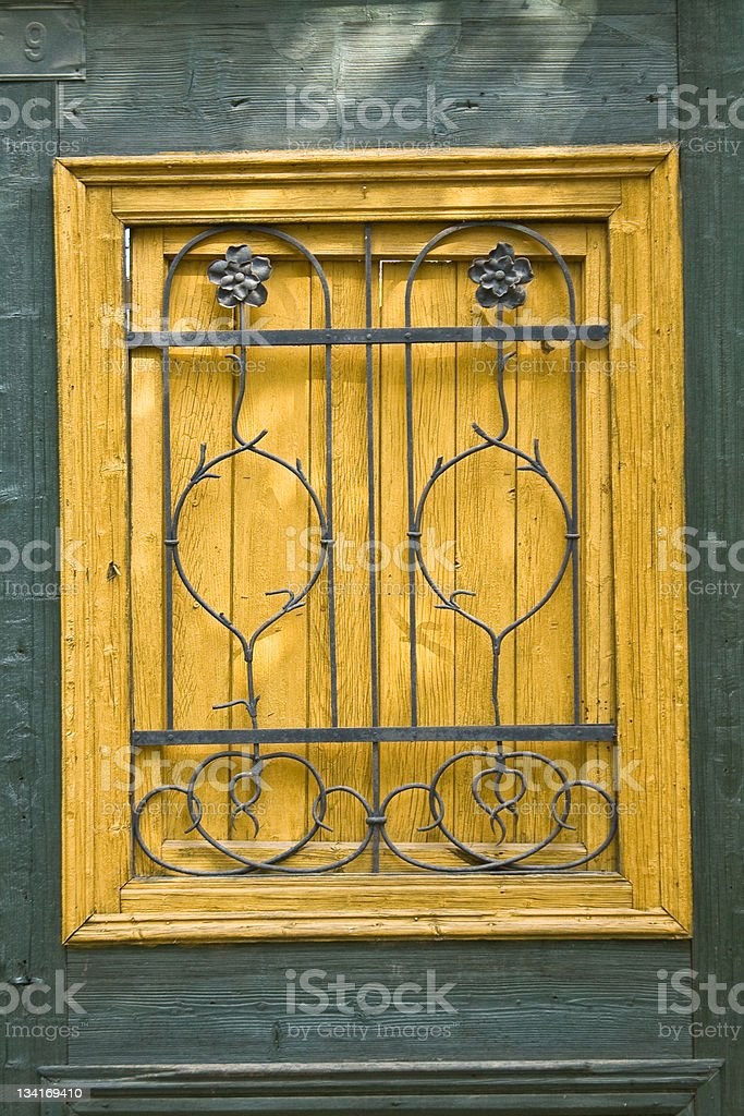 Old wooden door with metal ornaments royalty-free stock photo
