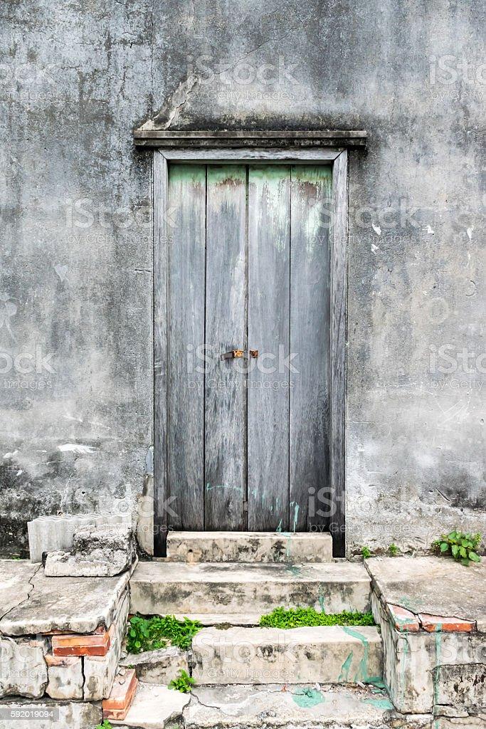 Old wooden door with old plaster walls. stock photo