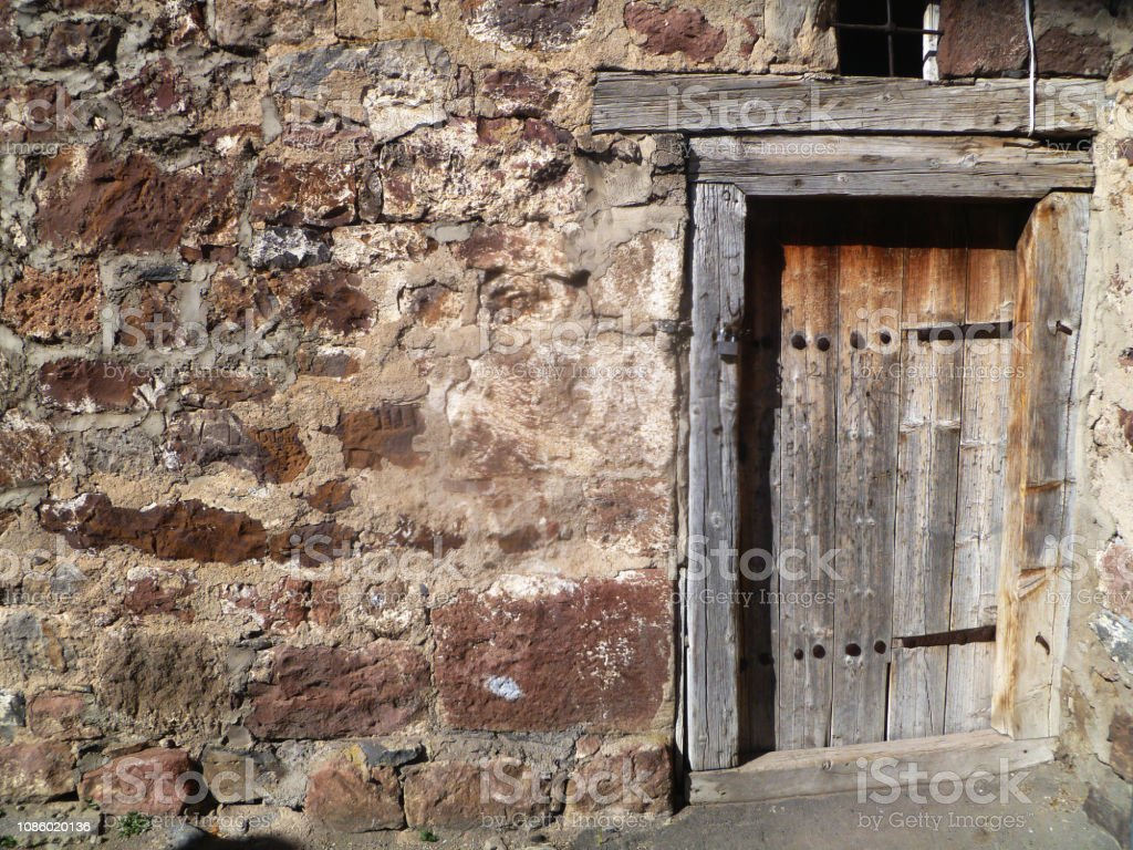 Old Wooden Door With Rusty Lock An Old Farmhouse Cellar