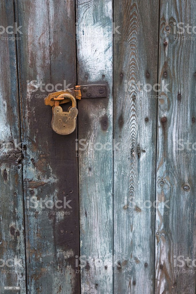 Old wooden door with rusty padlock royalty-free stock photo