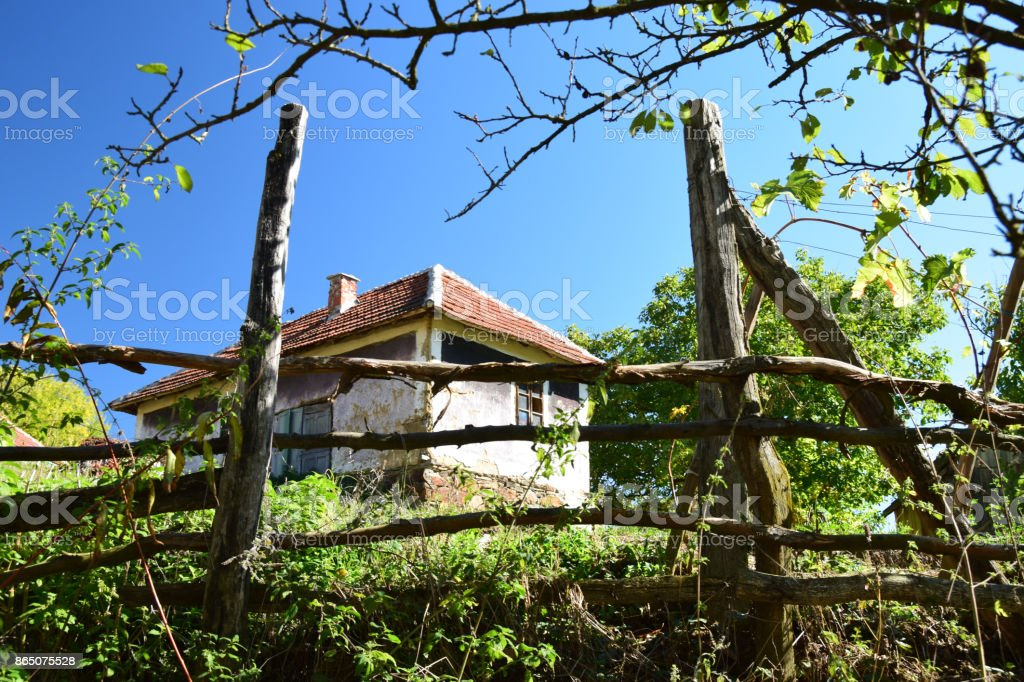Old wooden fence  in front of a country house stock photo
