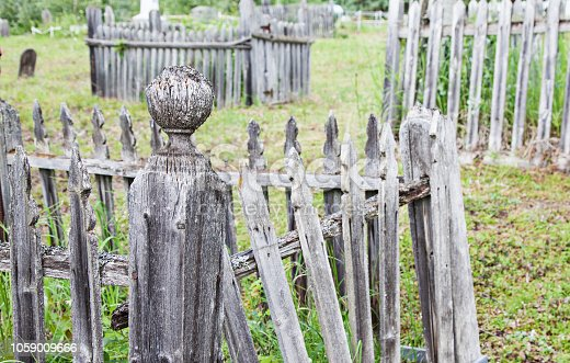 Weatherworn Wooden Fence pieces in an old cemetery