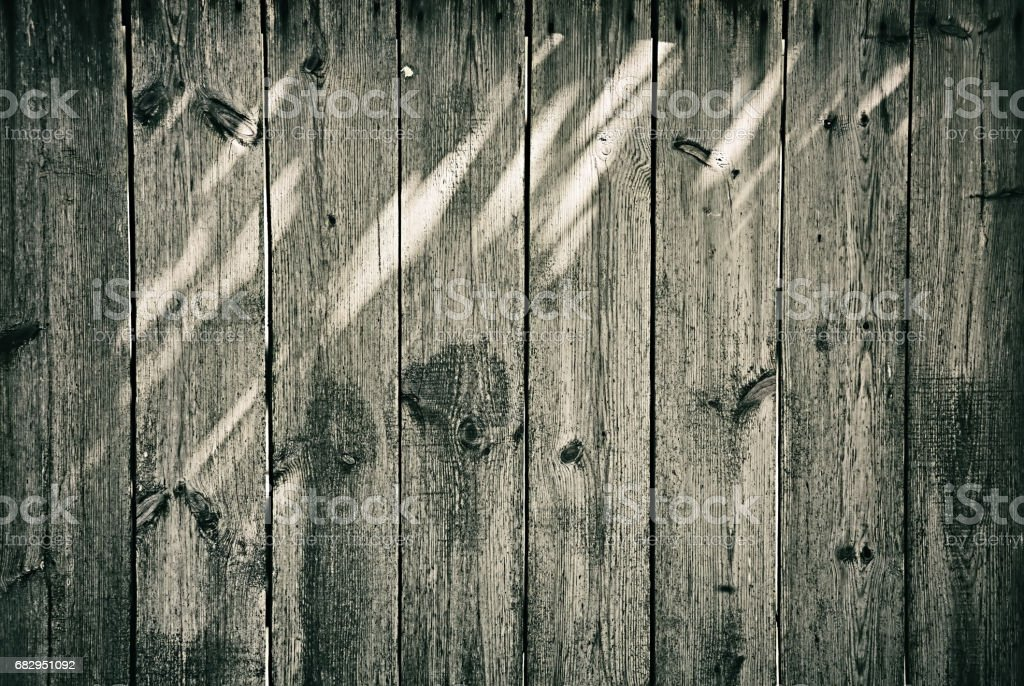 Old wooden fence with light spots background royalty-free stock photo