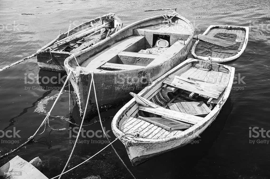 Old wooden fishing boats, black and white stock photo