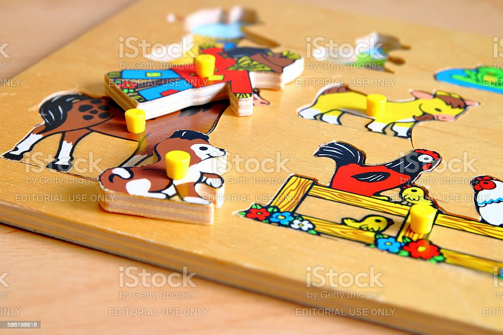 Old wooden flat shape sorter children's toy close-up selective focus stock photo