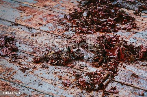 istock Old wooden floor with paint scraped - wooden floor renovation 1164417621
