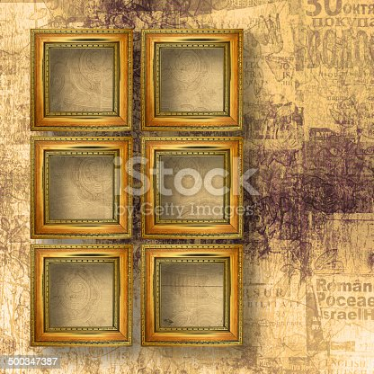 istock Old wooden frames for photo on the abstract paper background 500347387