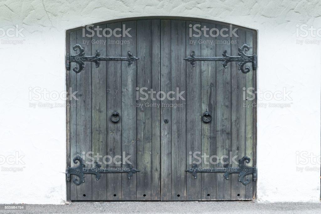 Old Wooden Garage Door With Ironwork Stock Photo More Pictures Of